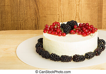 White cheddar cheese block with currants and blackberries