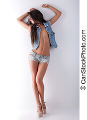 Pretty young girl topless posing in jeans - sexy young woman...