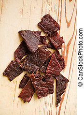 tasty beef jerky on kitchen table