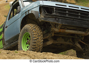 Off-road vehicle in terrain. - Off-road vehicle leaves a...