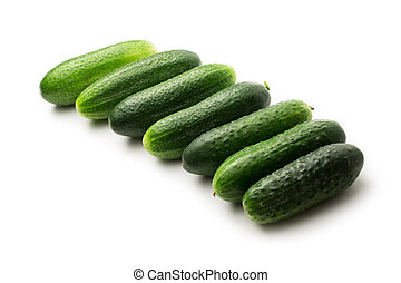 Fresh green cucumbers on white
