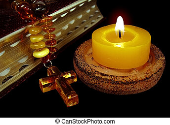 Belief candle - The macro - the bible photo with a gold...