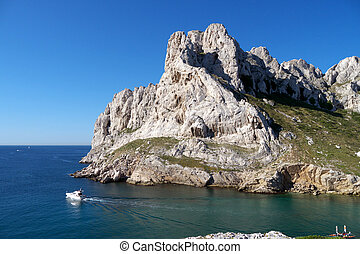calanques with a boat - boat cruising through the calanques...