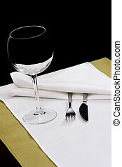 Knife, Fork and Glass on white linen cloth