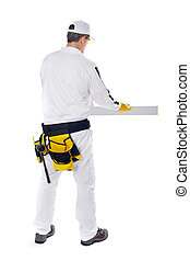 construction worker in white coveralls applied plaster on the wall of a building on a white background