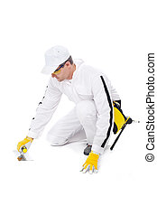 construction worker in white coveralls under repair with a trowel on a white background