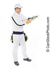 construction worker in white overalls gunned silicone on a white background