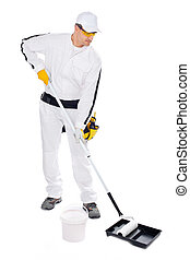 construction worker in white overalls with paint roller bucket o