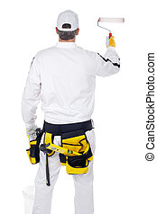 construction worker in white overalls with paint roller...