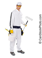 painter in white overalls holding paint roller with a short handle and a bucket of paint on a white background
