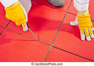 Sharp tool clean spaces between tiles remove tile adhesive...