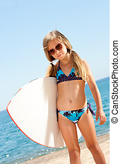 Cute gril ready to go surfing. - Portrait of cute girl in...
