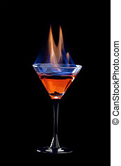 Flaming cocktail over black