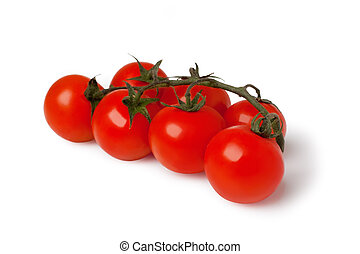 bunch of fresh cherry tomato on white background