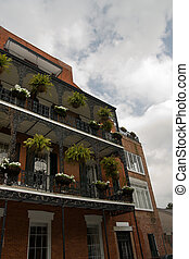French Quarter Balconies - lush vegetation adorns wrought...