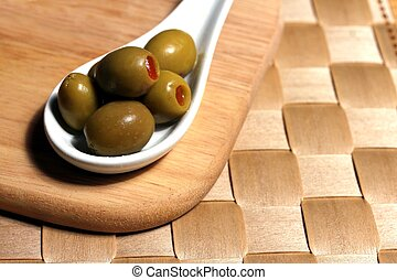 stuffed olives on a porcelain spoon