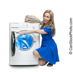 The happy young woman near the new washing machine