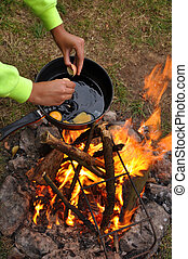 Campfire cooking - Frying pan with egg on Campfire