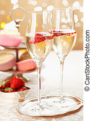 Romantic champagne and strawberries served on a silver tray...