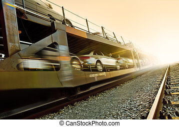 cars transport - car transportation by train at the sunset