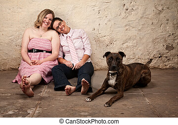 Sitting Friends With Dog - Cute female friends with pet dog...