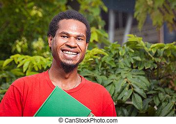 Happy dark skinned student - A happy dark skinned malel...