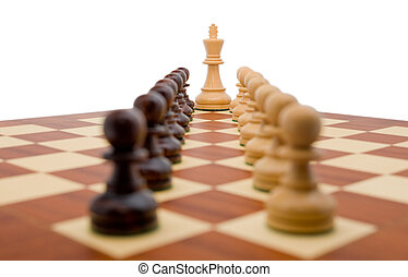 Chess pieces - a king guarded by two rows of pawns.