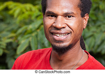 Portrait of a dark skinned young man - Close-up portrait of...