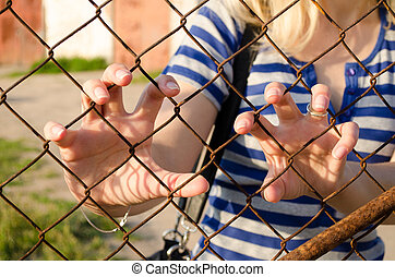 Woman hands claw rusty fence Human freedom stop - Woman claw...