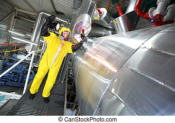 Technician torch checking system - Technician with torch in...