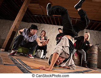 Freestyle Break Dancing - Young man showing friends...