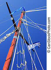 yacht's hinge with sail rolled-up