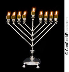 Chanukah oil menorah - Traditional Chanukah menorah lit with...
