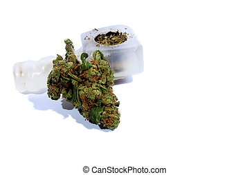 Marijuana and Pipe - Isolated marijuana bud laying by a pipe...