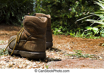Walking Boots on Pathway of Life - image is concept of...