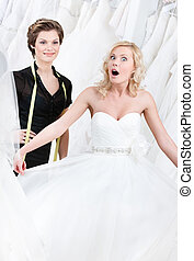Bride goes into raptures while seeing her wedding gown