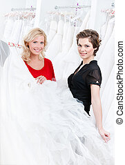 Bride is ready to try this wedding gown on