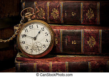 Old pocket watch and books in Low-key copy space - Antique...