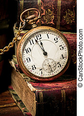 Old pocket watch and books in Low-key - Antique pocket clock...