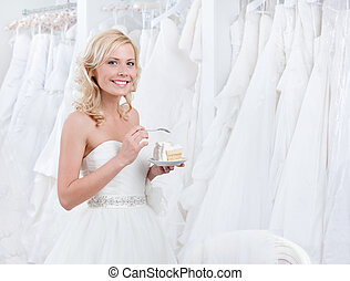 Happy bride tastes the cake - Happy bride tastes wedding...