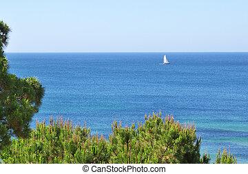 White sailboat on the sea.