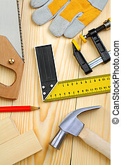 set of carpentry tools on wooden planks