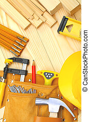 set of construction tools on wooden boards
