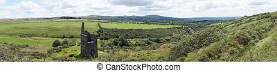 Panoramic view of Dartmoor landscape with derelict tin mine...
