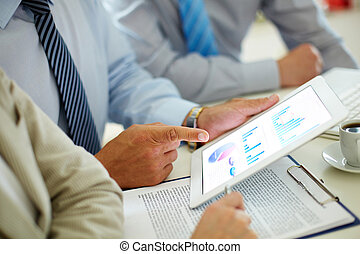 Business progress - Businessman pointing at the screen of...