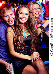 Friendly clubbers - Image of happy friends looking at camera...