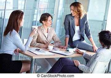 Female business - Pretty females discussing business matters...