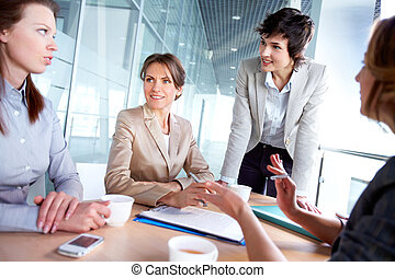 Female team - Female business team of four working together...