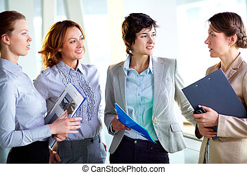 Women in business - Group of business ladies discussing...