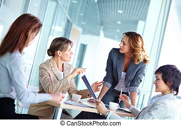 Female brainstorming - Lovely business ladies gathered for a...